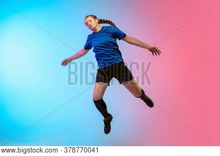 High Jumping. Female Soccer, Football Player Training In Action Isolated On Gradient Studio Backgrou