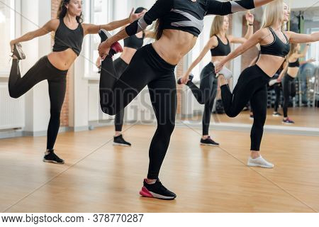 Group Of Women Doing Stretching Exercise For Legs, Closeup Photo