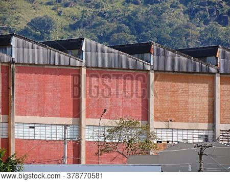 A Generic Factory Shed Facade. Industrial Architecture.