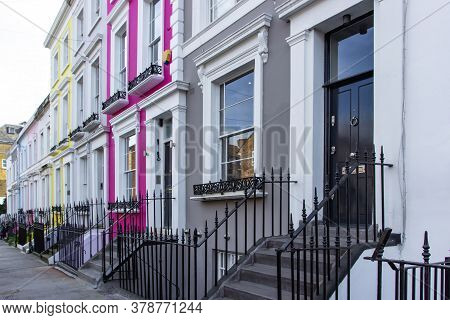 Row Of Colorful Typical Houses And Stairs In Notting Hill, London, Uk. Colorful English Houses Facad