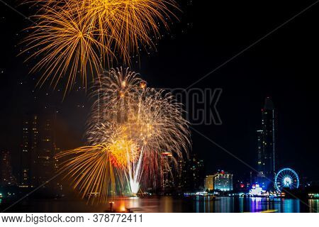Fireworks To Celebrate The Festival Of New Year At Bangkok Thailand. The Light Reflected The Chao Ph