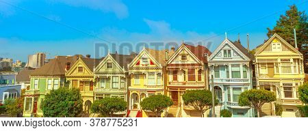 Panorama Of The Painted Ladies Of San Francisco, Colorful Victorian Houses. Urban Tourist Attraction