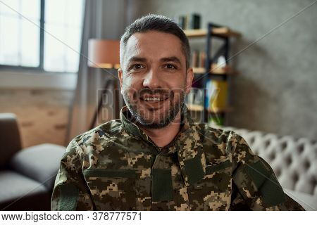 Portrait Of Middle Aged Military Man Looking At Camera With A Smile, During Therapy Session. Disable
