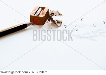 Pencil and Sharpener with pencil shavings