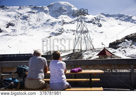 Austrian Old Man And Woman Lovers Travel Visit And Sit Looking Viewpoint Mein Gletscher Of Bergstati