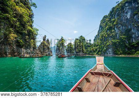 Wooden Longtail Boat Trip Adventure At Ratchaprapa Dam, Thailand