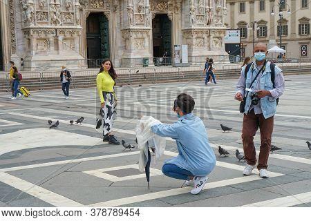 Milan - 6/17/2020 : A Young Girl Poses In Piazza Duomo Milan