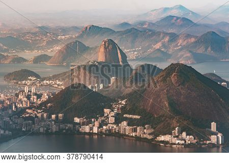 Hills Of Rio De Janeiro With The Sugarloaf Mountain Between Them