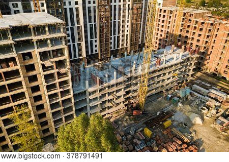 High Multi Storey Residential Apartment Buildings Under Construction. Concrete And Brick Framing Of