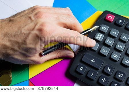 Top View Of A Male Hand Pressing A Calculator. Business Planning Concept Of Expenses And Income. Def