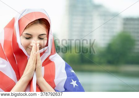 Portrait Of Young Refugee Woman With Usa National Flag On Her Head And Shoulders. Positive Muslim Gi