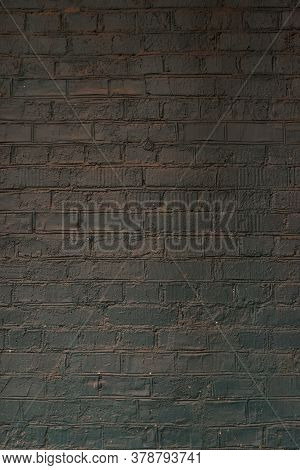 Brick Black Wall And Texture. Background Of A Old Brick House. Brickwork.