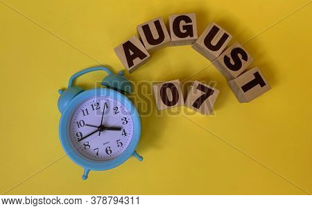 August 7.august 7 On Wooden Cubes On A Yellow Background.photos For The Holiday .the Last Month Of S