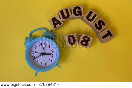 August 8.august 8 On Wooden Cubes On A Yellow Background.photos For The Holiday .the Last Month Of S