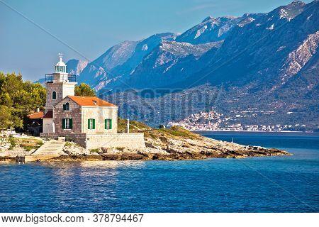 Lighthouse Of Sucuraj On Hvar Island And Biokovo Mountain Background View, Dalmatia Region Of Croati