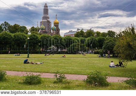Saint Petersburg, Russia - July 12, 2020: Residents Of Saint Petersburg Rest On The Field Of Mars On