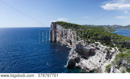 Landscape View Of The Telascica Cliffs From Seaside. There Are Cliffs In The Center With Some Mounta
