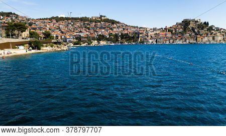 Landscape View Of The Sibenik Town. There Is A Beach On The Left Side And Some Fortification On The