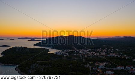 Sunset Over The Hill With Sea And Small Islands. There Is Small Town On The Left Side Of The Photo.