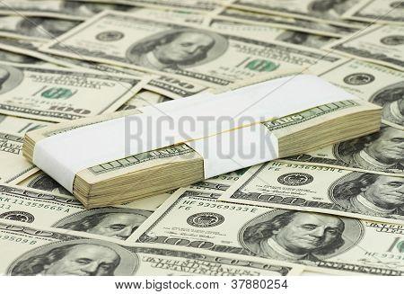 Ten Thousand Dollars Lying On Banknotes