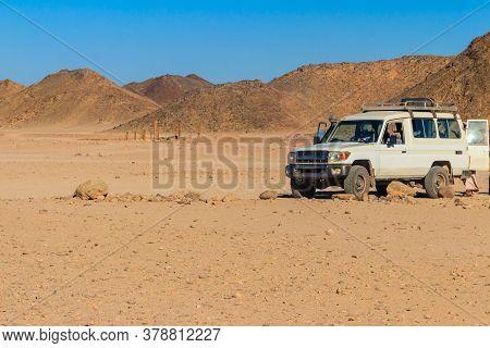 Off Road Suv Car In Bedouin Village In Arabian Desert Near Hurghada, Egypt