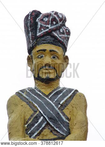 Carving Of Figure Of Batak Hunter With Traditional Colours And Design Of That Ethnic Group From The