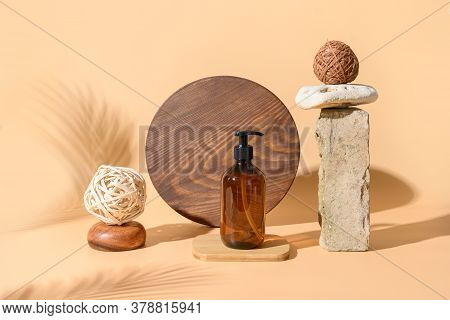 Brown Glass Bottle, Organic Natural Spa Accessories With Beige Stone Decor. Cosmetic Care Or Shampoo