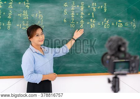 Asian Primary Teacher Tutor Explaining Math In Blackboard Giving Remote School Class Online Lesson T