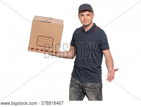 Portrait of Delivery man in cap holding big cardboard box. Handsome man looking on camera. Courier isolated on white background.