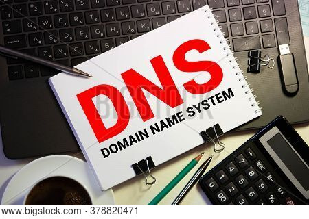 Dns- Domain Name System Written In Notebook On Wooden Background