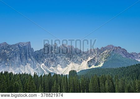 Panorama Of Lake Carezza An Alpine Lake Surrounded With Tall Pine Forest In The Dolomites With Rosen
