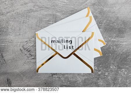 Email Marketing And Promoting Online Sales Concept, Group Of Email Icons And One Of Them With Mailin