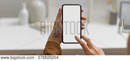Female Touching Smartphone With Clipping Path At Workspace In Home Office