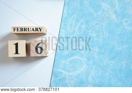 February 16, Empty White - Blue Background With Number Cube.