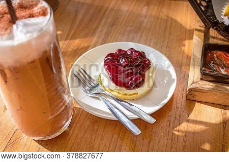 Blueberry Cheese Cake With Ice Mocha Coffee On Wood Table