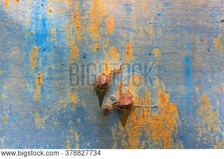 Dent On Rusty Iron Sheet With Day Light