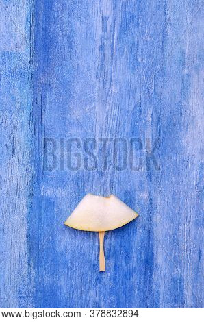 Slices Of Raw Melon On An Old Blue Wooden Background. Design Concept. Selective Focus.