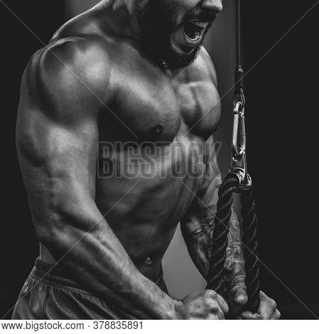 Close Up Of Healthy Fit Sporty Man Doing Exercise Tricebs, Dramatic Black And White Image