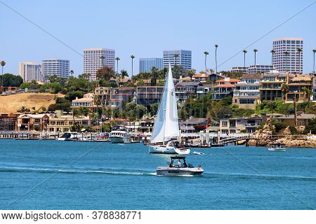 July 30, 2020 In Newport Beach, Ca:  Bluffs With Homes And Palm Trees Including Downtown Irvine, Ca