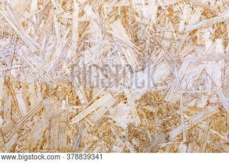 Construction Materials Made Of Chipboard. Osb Wood Panel Made Of Pressed Sand Brown Wood Shavings As