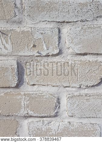 Background Grey Brick Wall With White Seams Close Up