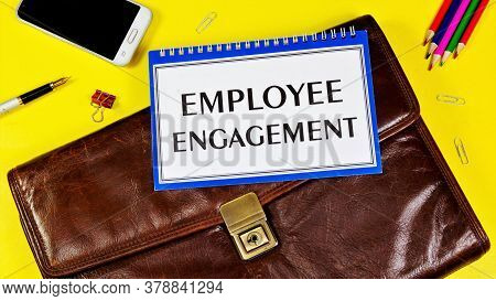 Employee Engagement - A Text Label In A Folder On The Office Briefcase. Motivation To Do A Better Jo