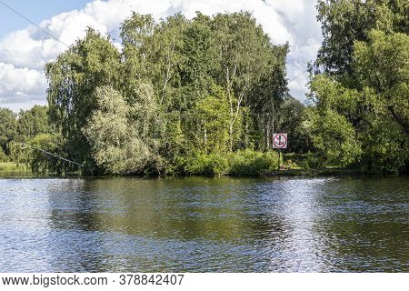 Navigational Sign On The Bank Of The Canal Prohibiting The Stopping Of River Vessels. Sign For Skipp