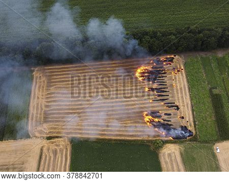 Plot Of Land With Straw, Fire In The Field, Burning Of Straw Residues, Environmental Air Pollution.
