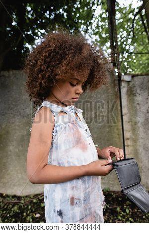 Beggar African American Kid Holding Wallet On Urban Street