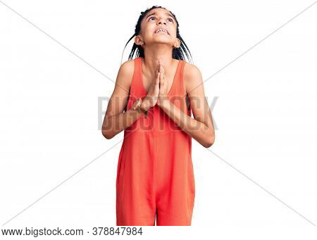 Cute african american girl wearing casual clothes begging and praying with hands together with hope expression on face very emotional and worried. begging.