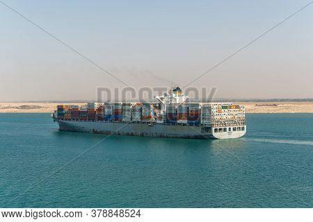 Suez, Egypt - November 14, 2019: Large Container Vessel Ship Amoliani Passing Suez Canal In Egypt. T