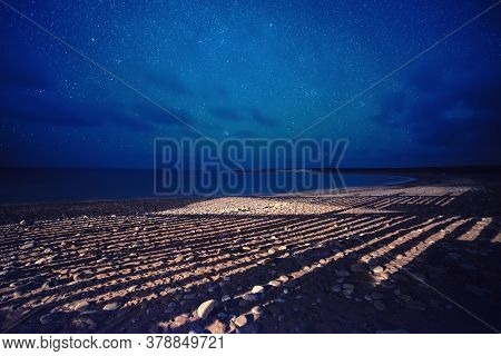 Cyprus Summer Landscape With Stars In The Sky And Strange Shadows On The Beach, Natural Starry Trave