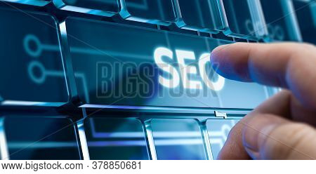 Man Using A Seo System By Pressing A Button On Futuristic Interface. New Business Concept
