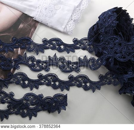 Tapes Of Blue Gentle Guipure, Beauty Silk Lace Fabric On Light Background. Elastic Material. Using F